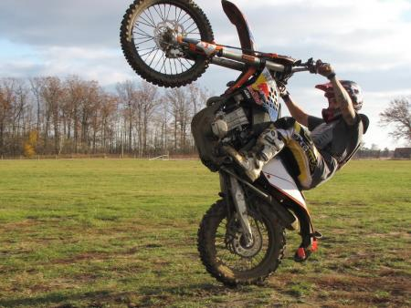 how to ride a wheelie on a dirt bike