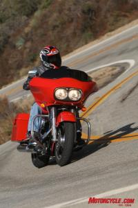 """Although the Road Glide's handling isn't quite as """"sporty"""" and doesn't offer as much lean angle as the Cross Country, the Glide is no slouch in the twists and turns. The updated frame from 2009 has dramatically improved handling on all Harley touring sleds."""