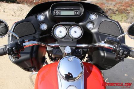 The Road Glide uses an array of analog dials for not only speed and rpm, but also for ambient air temp and oil pressure. A small LCD in the speedo provides mileage totals as well as a miles-remaining-until-empty counter. A single-disc CD player is part of the Harman/Kardon audio package.
