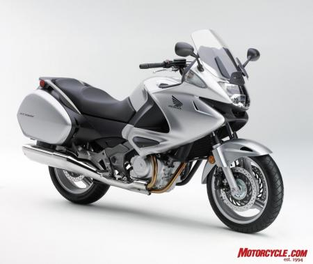 Honda Genuine Accessories include: Top Box, 45 liter Red and Silver ($392.95), Inner Bag-Trunk, Lower Top Box Pad, Fairing Wind Deflector Set, Knee Pad Set ($99.95), Heated Grips, DC Socket, Tank Pad ($64.95), and Outdoor Cycle Cover.