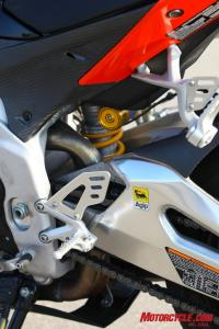Accessing some of the adjusters on the Aprilia�s shock is downright difficult when compared to reaching to fiddle with the KTM�s WP shock.