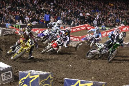 Dungey (5) takes the holeshot in Supercross main event. Davi Millsaps (18) and Ryan Villopoto (2) are right up there with him.