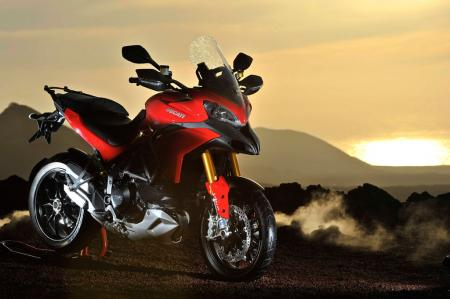 This is a Multistrada S Touring with its saddlebags removed. The Touring iteration also includes heated grips and a centerstand, also available in white and black.
