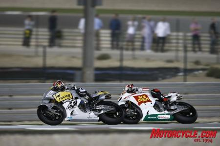 Hiroshi Aoyama fights off Marco Melandri. As he often did in his 2009 Championship-winning season, Aoyama finished ahead of his former rivals from the 250cc class.