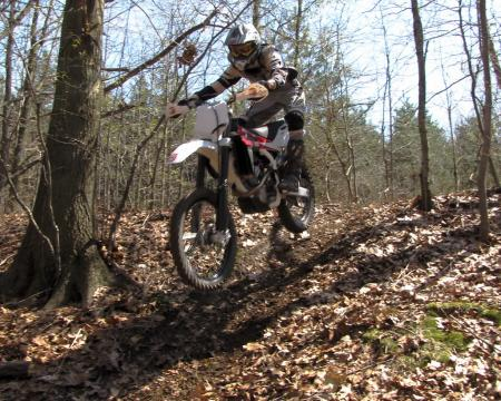 It's a motocross bike, but where the Husky TC 250 really excels is woods racing.