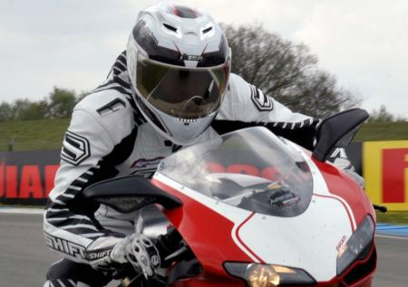 Icon's new top-line lid looks at home even on a $25K Ducati 1198S Corse.