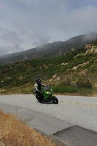 The Ninja 650R is a shown doing what it does best: sport riding on the street.