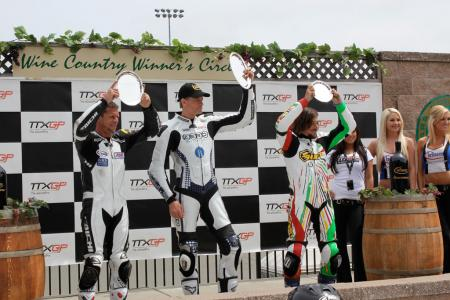 The TTXGP podium finishers celebrate history at Infineon Raceway, capped by race-winner Shawn Higbee. All three had quite different machines, yet circumstances and the state of TTXGP conspired to put them on the same podium.