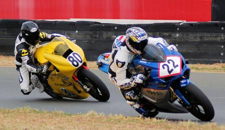 TTXGP race-winner Shawn Higbee (22) leads Michael Barnes (80) at Infineon Raceway. Barnie's bike had superior acceleration that offset Higbee's faster cornering speeds. Reliability issues for Barnes' bike stopped this battle and forced him to limp home in second place. (Photo by Mike Finnegan)