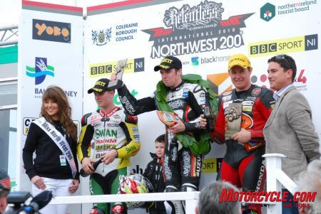 Seeley on the podium with second-place finisher, Stuart Easton (left), and John McGuinness (right) in third.