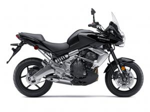 The asymmetry of the Versys is an exercise of form follows function. Note right-side mounted offset laydown shock, and the wide side of the alloy gullwing swingarm