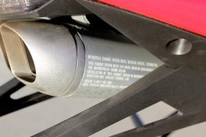 The 250R's undertail muffler makes big noises. It is stamped EPA-legal, but we were still wondering how it got through.