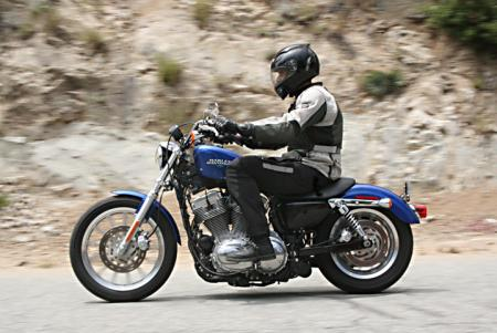 The H-D readily drags its exhaust on right-handed turns.