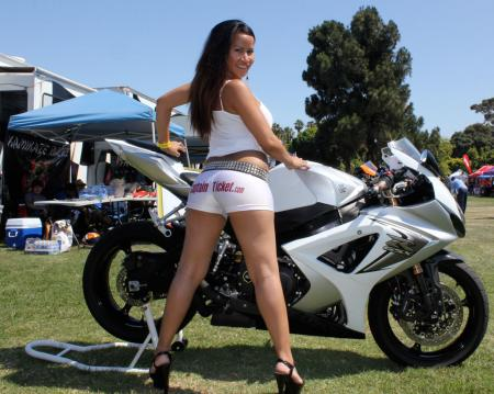 Showing a form-follows-function demonstration of high-performance equipment, a willing volunteer poses by Jon Seaman's tuned GSX-R1000.