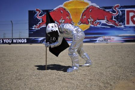 Jorge Lorenzo celebrated his win by dressing up as an astronaut planting his flag.