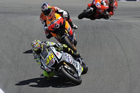 Valentino Rossi beat Andrea Dovizioso to take his first podium result since breaking his leg.