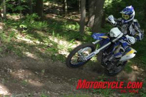 The Husaberg is heavy, but it feels surprisingly agile in the woods.
