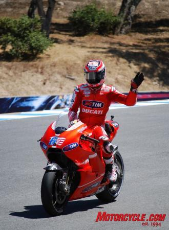 Nicky Hayden waves to the crowd in the Corkscrew at the end of the race. Despite no podium placing for Hayden, his sixth-place finish in the 2010 Laguna Seca MotoGP was respectable. American fans seemed to approve of his efforts.