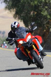 Although the Multistrada isn�t quite as adept at perfectly slicing up the curvy parts of the road, it nevertheless maintains about 80%, maybe even as much as 90%, of the sporting qualities of the VFR and Z. And it�ll bomb down a gravel road a lot better than the other two!