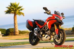 The Multistrada S Sport comes only with carbon-fiber bodywork replacement pieces as part of its upscale treatment. The 31-27 liter capacity hardbags are an $849 extra. Larger saddlebags with 39-34 liter capacity are available for $999.  However, the identically priced S Touring model has the lesser capacity bags, centerstand and heated grips as standard.
