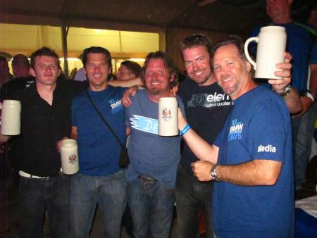 Under the big tent in the evenings at Motorrad Days everyone lets their hair down. (Jon Beck- second from left. Charlie Boorman – third from left. Jeff Buchanan – right).
