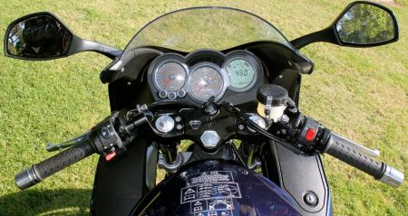 Cockpit view: Instruments are functional. Polished handlebar weights roll freely when twisted. Hitting the red right-side kill button shuts off the electricity to the instruments but leaves headlights on. Note lockable right side compartment in fairing. Very handy.