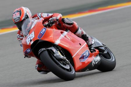 "Nicky Hayden finally got his podium appearance after finishing fourth four times. Hayden used a new larger fairing on his Desmosedici. Note it does not have the ""wings"" located in front of the large vent on the side panels as seen on Casey Stoner's bike pictured above."