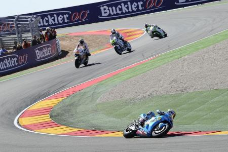 Alvaro Bautista makes his way through the Aragon circuit's take on the Corkscrew with Marco Melandri, Randy de Puniet and Aleix Espargaro following.