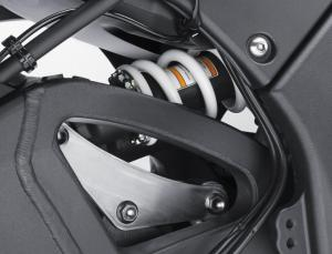 A new shock arrangement offers shelter from exhaust heat, stabilizing its damping performance.
