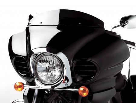 The Vaquero�s frame-mounted fairing is essentially the same fairing used on the Vulcan Voyager, but on the Vaquero the windshield is �chopped� to enhance the bike�s custom look. Accessory fog lamps can take the place of the faux louvers flanking the headlight.