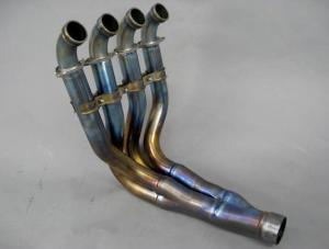 This beautiful exhaust header is made of lightweight titanium and is claimed to have nearly the same diameter and length as factory racing headers, so a simple aftermarket slip-on muffler should yield a better-than-typical performance boost.