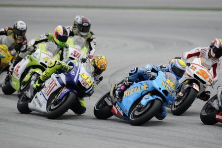Before winning the Malaysian Grand Prix, Valentino Rossi took a rare opportunity to learn what the back of a Suzuki GSV-R looks like.