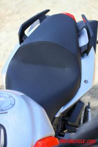 A narrower saddle joins lower handlebars and footpegs moved rearward as refinements to rider ergos on the latest Shiver. A flyscreen is now also standard.