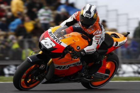Dani Pedrosa tried to race despite a broken collarbone but withdrew from the Australian Grand Prix after qualifying 14th.