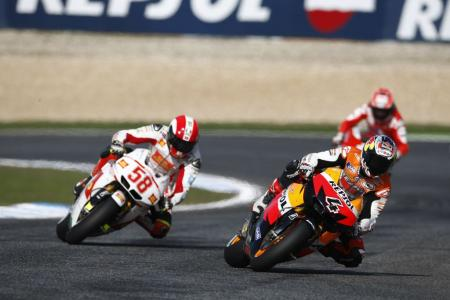 Dueling Hondas Andrea Dovizioso (4) and Marco Simoncelli (58) fought for the final podium position.
