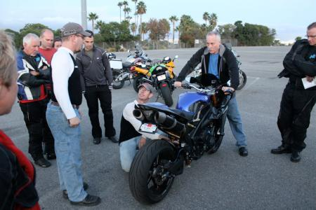 Lee Parks, Terry Watts (center) and Tracy Martin (right) show how to set sag, rebound and compression damping on what Parks said was the most blinged out motorcycle to have come through his classes. This R1 had been kitted with Ohlins suspension, motor work, and carbon fiber everything, including wheels, brakes, fairing.