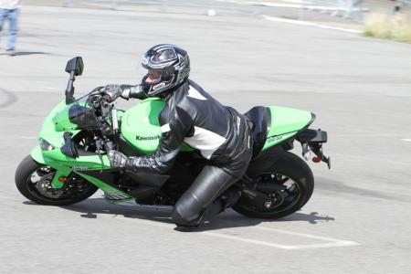 This pic catches me at a moment of far less than ideal form. I�m looking straight ahead, my inside arm is stiff, my body�s centerline is too close to the centerline of the bike. Performing under the watchful eye of instructors made me self-conscious.