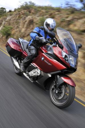 A sport-touring rider is coddled by many luxury and technology features, yet it�s surprisingly competent when presented with a twisty road. This vermillion red metallic version is joined by a light grey metallic option.