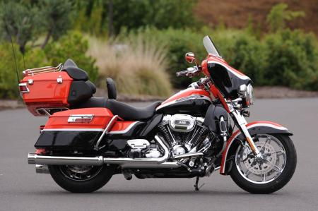 The 2012 CVO Ultra Classic Electra Glide in Electric Orange & Black Diamond with Big City Lights Graphics.