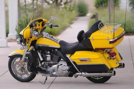 The 2012 CVO Electra Glide is available in three color schemes, including this Crystal Citron & Diamond Dust with Big City Lights Graphics version.
