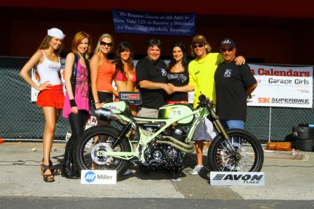 "The 2011 LA Calendar Motorcycle Best of Show winner ""Sentoh from AFT Customs. From the left: FastDates.om Calendar Kitten Camilla, hostess Emily Jaye, AFT Customs models and builders Shelby, Nelani, event promoter Jim Gianatsis, builders Sarah and Jim Giuffra, and show assistant Lee Chapin."
