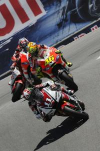 Ben Spies leads Ducati's Valentino Rossi and Nicky Hayden through The Corkscrew.