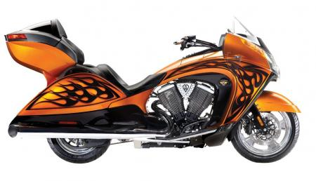 Arlen Ness and family continue in 2012 to add their unique styling influences to three of Victory's bikes. Here is the Arlen Ness Victory Vision in Nuclear Sunset with custom Ness flamed graphics. Ness' son, Cory, put his touch on the Cory Ness Cross Country, while Cory's son, Zach, styled the Zach Ness Vegas 8-Ball.