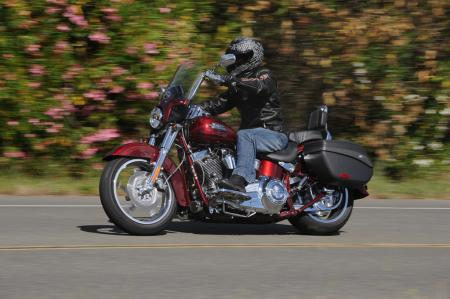 2012 Harley-Davidson CVO Softail Convertible red left action 0787