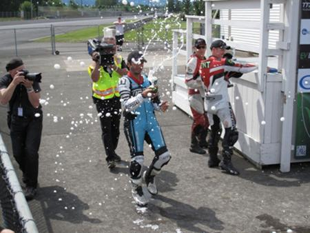 Racing Electric Motorcycles Champagne Celebration
