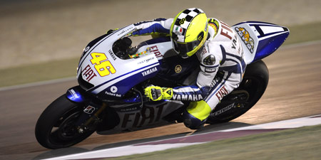 Valentino Rossi will begin his title defence under the lights at Qatar.