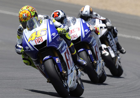 Fiat Yamaha's Valentino Rossi and Jorge Lorenzo ahead of the surprising Randy de Puniet from the Playboy-sponsored LCR Honda.