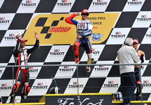 Jorge Lorenzo does his traditional podium leap while Marco Melandri earns Kawasaki's first podium since 2006.