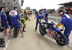 Valentino Rossi was swaps bikes in one of his many visits to the pits on Sunday.