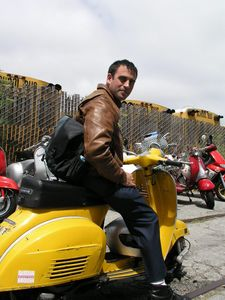 """[T]he utter charm of riding such an odd duck on city streets, performing the task it was designed to do after half a century is overwhelming."""